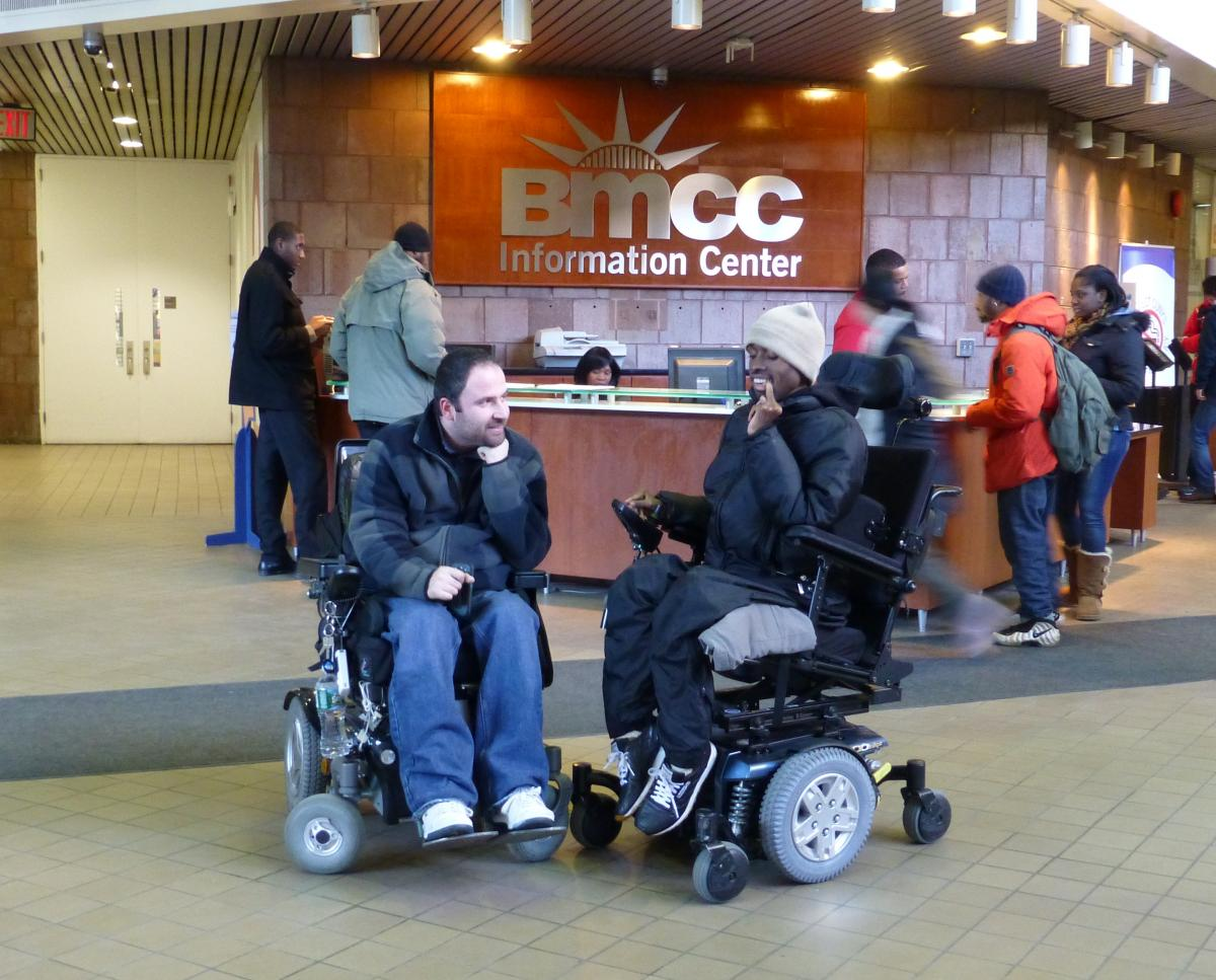 khiry in front of bmcc information desk